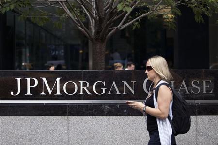 Woman walks past JP Morgan Chase's international headquarters on Park Avenue in New York