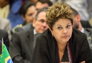Originally scheduled for October, the state visit will take place as soon as possible after the U.S. government explains allegations that it spied on Brazilian President Dilma Rousseff and Brazilian companies, Brazil's presidential press office said in a statement posted on its website. (Photographer: Jody Amiet/AFP via Getty Images)
