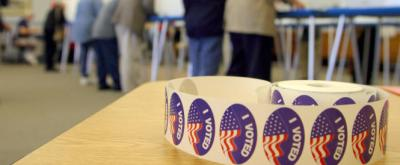 """A roll of """"I Voted"""" stickers is photographed on one of the check-out station tables at Barnstable Town Hall in Hyannis, Mass., Tuesday, Nov. 2, 2004. Voters were offered a sticker after casting their ballots. (AP Photo/Julia Cumes)"""