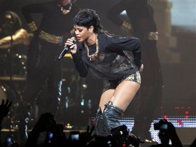 FILE - In this Sept. 24, 2013 file photo, Rihanna performs in Perth, Australia during the first concert of the Australian leg of her Diamonds World Tour. Thai authorities arrested a bar owner in connection with a lewd sex show mentioned in racy tweets by pop star Rihanna during her recent trip to Thailand, officials said Monday, Oct. 14, 2013, two weeks after an Instagram photo of her with a protected primate led to the arrest of other two men. (AP Photo/Lee Griffith, File)