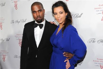 In this Oct. 22, 2012 file photo, singer Kanye West and girlfriend Kim Kardashian attend Gabrielle's Angel Foundation 2012 Angel Ball cancer research benefit at Cipriani Wall Street in New York.  (Photo by Evan Agostini/Invision/AP, File)