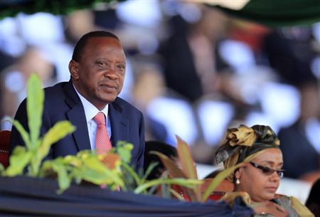 Kenya's President Kenyatta, accompanied by his wife Margaret, attends Mashujaa Day at the Nyayo National Stadium in capital Nairobi
