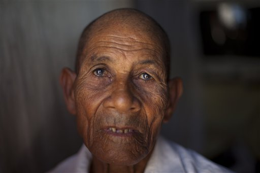 In this Nov. 12, 2013 photo, Calmelo Novas, 84, one of many people of Haitian descent fearing the effects of a recent Dominican court ruling on citizenship, sits in the doorway of his home in Jimani, Dominican Republic, near the border with Haiti. A Dominican Constitutional Court ruling that being born in the country does not automatically grant citizenship is a reflection of deep hostility in the Dominican Republic to the vast number of Haitians who have come to live in their country, many brought over to work in the sugar industry. (AP Photo/Dieu Nalio Chery)
