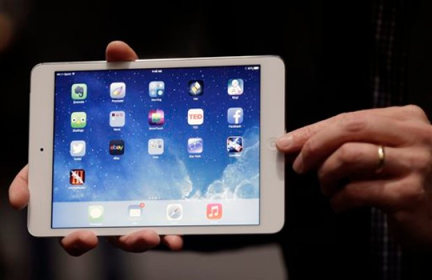 In this Tuesday, Oct. 22, 2013, file photo, an Apple employee demonstrates the new iPad Mini in San Francisco. Apple began selling a new iPad Mini on Tuesday, Nov. 12, 2013,  without the usual fanfare. (AP Photo/Marcio Jose Sanchez, File)