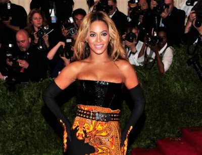 """This May 6, 2013 file photo shows singer Beyonce at The Metropolitan Museum of Art's Costume Institute benefit in New York.  Beyonce has released her new album in an unconventional way: She announced and dropped it on the same day. The singer released """"Beyonce"""" exclusively on iTunes early Friday, Dec. 13.  (Photo by Charles Sykes/Invision/AP, File)"""