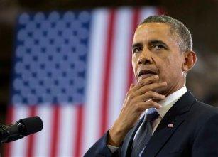 President Barack Obama pauses as he speaks at McGavock High School, Thursday, Jan. 30, 2014, in Nashville, Tenn., about education. (AP Photo)