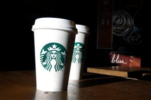 This Friday, Jan. 17, 2014,  photo, shows Starbucks mugs in a cafe in North Andover, Mass. Starbucks reports quarterly earnings on Thursday, Jan. 23, 2014. (AP Photo/Elise Amendola)