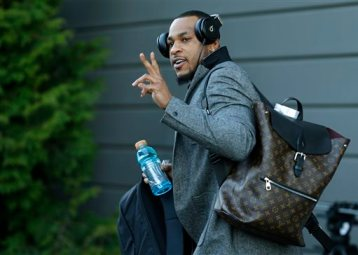 Seattle Seahawks wide receiver Percy Harvin leaves team headquarters in Renton, Wash., Sunday, Jan. 26, 2014, to board a bus for his flight to play the Denver Broncos in the NFL Super Bowl XLVIII football game in East Rutherford, N.J. (AP Photo/Ted S. Warren)