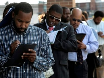 Jamal Randle, from left, Loren Cowling, and Dave Jackson fill out applications for positions at a new bar and restaurant in Detroit, Sept. 25, 2009. (AP Photo/Paul Sancya)