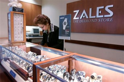 In this Jan. 4, 2007, a Zales jewelry store worker looks at watches in San Bruno, Calif. (AP Photo/Paul Sakuma, file)