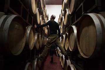 In this Tuesday, Feb. 11, 2014 photo, Israeli workers inspects barrels in a winery in the West Bank settlement of Psagot (AP Photo/Dan Balilty)