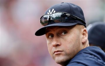 in a Sept. 14, 2013 file photo, New York Yankees' Derek Jeter  looks on from the dugout during their 5-1 loss to the Boston Red Sox in a baseball game at Fenway Park in Boston. (AP Photo/Winslow Townson, File)