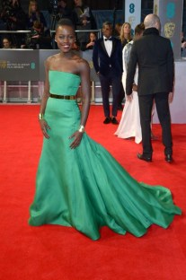 Kenyan actress Lupita Nyong'o poses for photographers on the red carpet at the EE British Academy Film Awards held at the Royal Opera House on Sunday Feb. 16, 2014, in London. (photos by Jon Furniss/ Invision/AP)