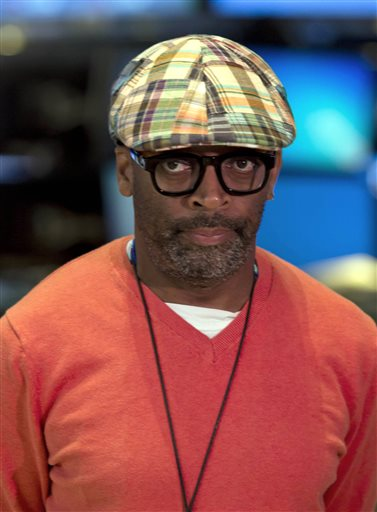 This July 31, 2013, file photo shows filmmaker Spike Lee being interviewed on the floor of the New York Stock Exchange (AP Photo/Richard Drew, File)