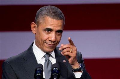 President Barack Obama speaks at the National Organizing Summit in Washington, Tuesday, Feb. 25, 2014.   (AP Photo/Manuel Balce Ceneta)
