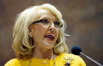 In this Jan. 13, 2014 file photo, Arizona Gov. Jan Brewer speaks during her State of the State address at the Arizona Capitol in Phoenix. (AP Photo/Ross D. Franklin, File)