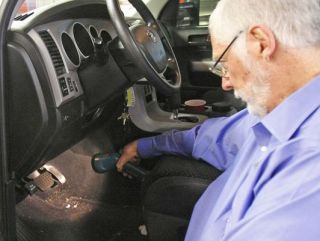 Earl Stewart, owner of Earl Stewart Toyota, shows the faulty accelerator pedal on a recalled vehicle in North Palm Beach, Fla. in this 2010 photo (Photo: Alan Diaz AP)
