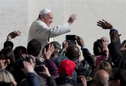 "Pope Francis greets the crowd as he arrives for his weekly general audience in St. Peter's Square at the Vatican, Wednesday, March 5, 2014. The pontiff  says he finds the hype that is increasingly surrounding him ""offensive."" In an interview with Italian daily Corriere della Sera, Francis said he doesn't appreciate the myth-making that has seen him depicted as a ""Superpope"" who sneaks out at night to feed the poor. On Wednesday, a new Italian weekly hit newsstands — a gossip magazine devoted entirely to the pope. Francis said: ""The pope is a man who laughs, cries, sleeps calmly and has friends like everyone else. A normal person."" (AP Photo/Alessandra Tarantino)"