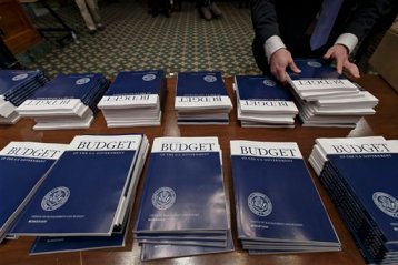 Copies of President Barack Obama''s proposed fiscal 2015 budget are set out for distribution by Senate Budget Committee Clerk Adam Kamp, on Capitol Hill in Washington, Tuesday, March 4, 2014. (AP Photo/J. Scott Applewhite)