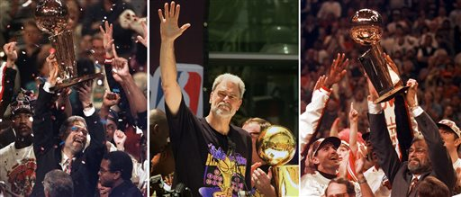 At left, in a  June 13, 1997, file photo, Chicago Bulls coach Phil Jackson hoists the NBA Championship trophy aloft after the Bulls beat the Utah Jazz 90-86 in Game 6 of the NBA Finals. in Chicago. At center, in a June 21, 2000 file photo, Los Angeles Lakers head coach Phil Jackson waves to the crowd as the Lakers and thousands of their fans celebrate their NBA Championship in downtown Los Angeles. At right, in a June 16, 1996 file photo, Chicago Bulls coach Phil Jackson hoists the NBA championship trophy after the Bulls beat Seattle in Game 6 of the NBA Finals in Chicago. (AP Photo/File)