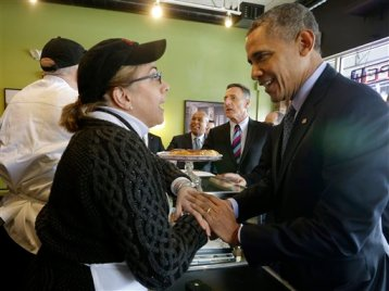 President Barack Obama greets owner Alice Bruno and her husband Rob Chiovoloni, far left, during his unannounced visit to Café Beauregard in New Britain, Conn., Wednesday, March 5, 2014. Also at the counter with Obama are Massachusetts Gov. Deval Patrick, center, and Vermont Gov. Peter Shumlin. Obama traveled to Hartford, Conn., area to highlight the importance of raising the minimum wage and then will travel to Boston for a pair of Democratic fundraising. (AP Photo/Pablo Martinez Monsivais)