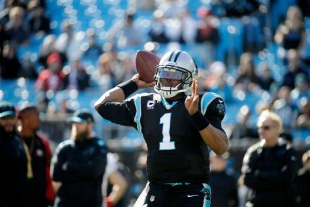 In this Jan. 12, 2014, file photo, Carolina Panthers quarterback Cam Newton warms up before a divisional playoff NFL football game against the San Francisco 49ers in Charlotte, N.C. The Panthers have announced that Newton will undergo surgery Wednesday, March 19, on his left ankle and will be sidelined for four months. (AP Photo/John Bazemore, File)