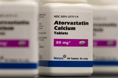 This 2011 photo provided by Watson Pharmaceuticals Inc. shows bottles of Atorvastatin Calcium tablets, a generic form of Lipitor which is sold under a deal with Pfizer. (AP Photo/Watson Pharmaceuticals Inc., Bill Gallery)