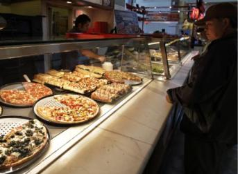 A customer looks at pizzas at Sbarro restaurant in San Jose, Calif. (Paul Sakuma/AP Photo)