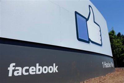This Tuesday, July 16, 2013 file photo shows a sign at Facebook headquarters in Menlo Park, Calif. Facebook reports quarterly earnings on Wednesday, April 23, 2014. (AP Photo/Ben Margot, File)