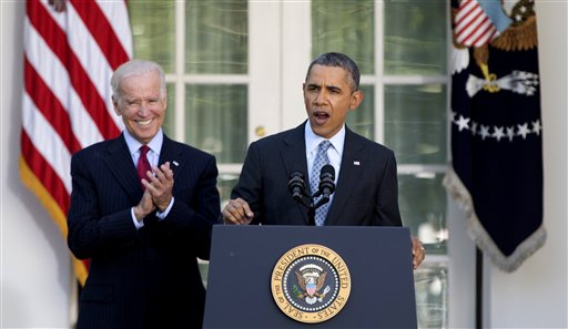 President Barack Obama, with Vice President Joe Biden, speaks in the Rose Garden of the White House in Washington, Tuesday, April 1, 2014, about the Affordable Care Act. The deadline to sign up for health insurance under the Affordable Care Act passed at midnight Monday night. (AP Photo/Carolyn Kaster)