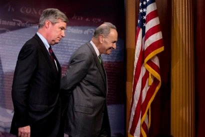 Sen. Charles Schumer, D-N.Y., right, followed by Sen. Sheldon Whitehouse, D-R.I. leave a news conference on Capitol Hill in Washington, Wednesday, April 2, 2014, where they talked about the Supreme Court decision in the McCutcheon vs. FEC case, in which the Court struck down limits in federal law on the aggregate campaign contributions individual donors may make to candidates, political parties, and political action committees. (AP Photo/Manuel Balce Ceneta)