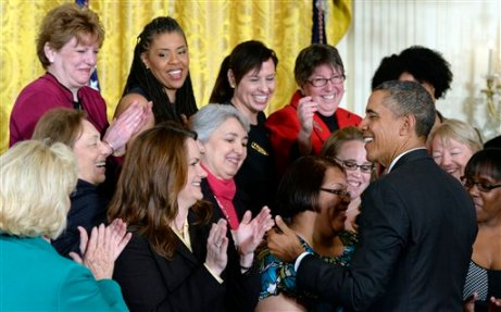 President Barack Obama greets people in the East Room of the White House in Washington, Tuesday, April 8, 2014, during an event marking Equal Pay Day. The president announced new executive actions to strengthen enforcement of equal pay laws for women. The president and his Democratic allies in Congress are making a concerted election-year push to draw attention to women's wages. Lilly Ledbetter is at left in green. (AP Photo/Susan Walsh)