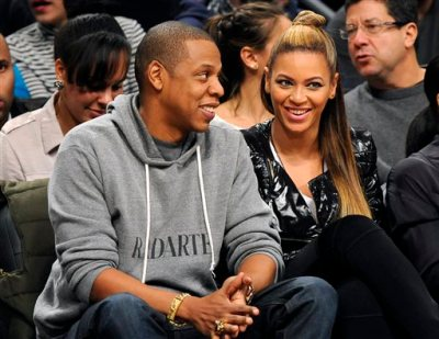 "This Nov. 23, 2012 file photo shows entertainers Jay Z and his wife Beyonce at the Brooklyn Nets against the Los Angeles Clippers NBA basketball game at Barclays Center in New York. The couple will launch the co-headlining ""On the Run Tour"" on June 25 in Miami. (AP Photo/Kathy Kmonicek, File)"