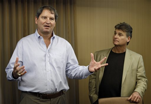 "In this Jan. 10, 2013 file photo, former Cleveland Browns quarterback Bernie Kosar, left, speaks at a news conference with Dr. Rick Sponaugle, in Middleburg Heights, Ohio . Thursday, Jan. 10, 2013. Kosar believes he's been unfairly sacked as a TV broadcaster. Kosar contends he's been removed because of slurred speech he attributes to ""a direct result of the many concussions I received while playing in the NFL."" (AP Photo/Mark Duncan, File)"