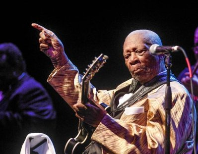 """In this April 4, 2014 photo, B.B King performs at the Peabody Opera House on April 4, 2014 in St. Louis, Mo.  Some St. Louis music fans are singing the blues after an erratic weekend performance by 88-year-old guitar legend B.B. King led to a stream of early departures and audience catcalls.  Concert-goers say King's rambling Friday night set at the Peabody Opera House included only a handful of complete songs amid musical snippets, long-winded soliloquies and a 15-minute sing-along of """"You Are My Sunshine.""""  (AP Photo/St. Louis Post-Dispatch, Sarah Conard)"""