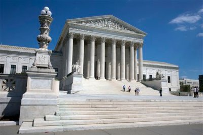 People walk on the steps of the U.S. Supreme Court in Washington on Saturday April 26, 2014. (AP Photo/Jacquelyn Martin)