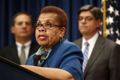 In this May 31, 2013, file photo, acting Social Security Commissioner Carolyn W. Colvin, center, accompanied by Acting Labor Secretary Seth D. Harris, left, and Treasury Secretary Jacob Lew, speaks during a news conference about Social Security and Medicare in Washington. The Social Security Administration is suspending a program in which thousands of people were having their tax refunds seized to recoup overpayments that happened more than a decade ago. Colvin said Monday, April 14, 2014, she has directed an immediate halt to the program while the agency does a review. (AP Photo/Charles Dharapak, File)