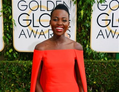 In this Jan. 12, 2014 file photo, Lupita Nyong'o arrives at the 71st annual Golden Globe Awards at the Beverly Hilton Hotel, in Beverly Hills, Calif. The Mexican-born Kenyan will be the first black ambassador for Lancome, which features Julia Roberts, Kate Winslet, Penelope Cruz and Lily Collins as spokeswomen. (Photo by Jordan Strauss/Invision/AP, File)