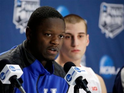 Kentucky's Julius Randle, left, and Wisconsin's Ben Brust participate in a news conference for their NCAA Final Four tournament college basketball semifinal game Thursday, April 3, 2014, in Dallas. (AP Photo/David J. Phillip)