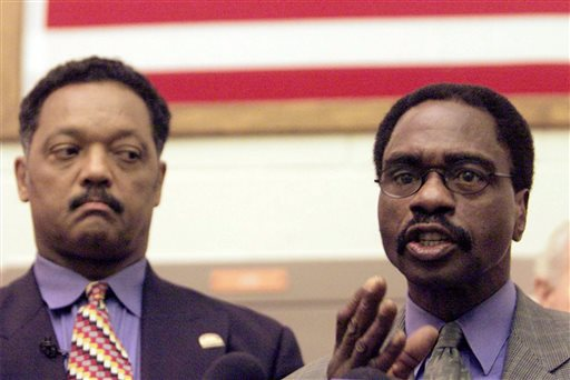 "In this March 3, 2000 file photo, the Rev. Jesse Jackson, left, listens as Rubin ""Hurricane"" Carter, the former middleweight boxer, speaks during a news conference inside the North County Correctional Facility in Castaic, Calif. Carter, who spent almost 20 years in jail after twice being convicted of a triple murder he denied committing, died at his home in Toronto, Sunday, April 20, 2014, according to long-time friend and co-accused John Artis. He was 76. (AP Photo/Damian Dovarganes, File)"