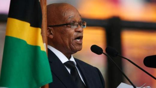 South African President Jacob Zuma reads his speech during the memorial service for former South African president Nelson Mandela at the FNB Stadium in Soweto near Johannesburg, Tuesday, Dec. 10, 2013. (AP Photo/Matt Dunham)