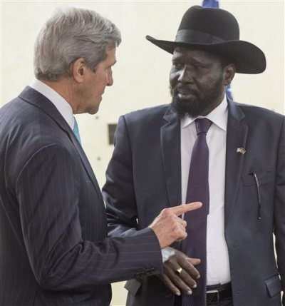South Sudan's President Salva Kiir, right, listens to U.S. Secretary of State John Kerry as he greets Kerry at the President's Office in Juba, South Sudan, Friday, May 2, 2014. Kerry is urging South Sudan's warring government and rebel leaders to uphold a monthslong promise to embrace a cease-fire or risk the specter of genocide through continued ethnic killings. (AP Photo/Saul Loeb, Pool)