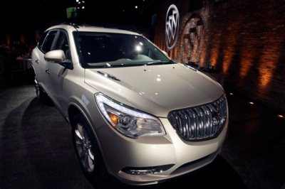 This April 3, 2012 file photo shows the 2013 Buick Enclave as it is unveiled at a news conference ahead of the New York International Car Show, in New York. General Motors on Tuesday, May 20, 2014 announced the recall of 2.4 million vehicles in the U.S., including the 2013 Enclave and other full-size crossovers from the 2009-2014 model years, as part of a broader effort to resolve outstanding safety issues more quickly. (AP Photo/Mary Altaffer, File)