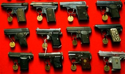 Guns line the walls of the firearms reference collection at the Washington Metropolitan Police Department headquarters in Washington on Sept. 28, 2007. (AP Photo/Jacquelyn Martin)