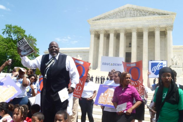 Jitu Brown speaks at a Brown v. Board of Education rally in Washington, DC (Jazelle Hunt/NNPA)