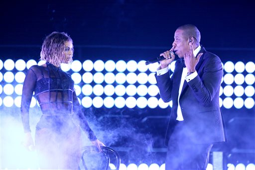 """This Jan. 26, 2014 file photo shows Beyonce, left, and Jay Z performing """"Drunk in Love"""" at the 56th annual Grammy Awards in Los Angeles. Beyoncé and Jay Z lead in nominations for the BET Awards. The network announced Wednesday that the performers are both nominated for five awards, along with Drake. Pharrell and rising performer August Alsina have four nominations. The BET Awards will air live on June 29 from the Nokia Theatre L.A. Live. (Photo by Matt Sayles/Invision/AP, File)"""