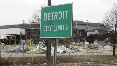 A street sign showing Detroit's city limits is shown near where a former Chrysler McGraw glass plant is being torn down along Ford Road in Detroit, March 22, 2011. (AP)