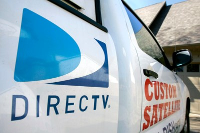 In this photo made Tuesday, Nov. 3, 2009, an installer's truck is parked outside a DirecTV customer's home in Little Rock, Ark. (AP Photo/Danny Johnston)