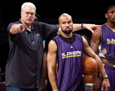 In this file photo from June 16, 2010, then Los Angeles Lakers coach Phil Jackson, left, directs Derek Fisher during NBA basketball practice in Los Angeles. The New York Knicks have scheduled a news conference for Tuesday, June 10, 2014, amid reports that Fisher has agreed to become the team's basketball head coach. (AP Photo/Reed Saxon)