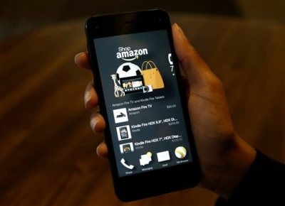 The app that links to shopping on Amazon.com is shown on the new Amazon Fire Phone, Wednesday, June 18, 2014, in Seattle. (AP Photo/Ted S. Warren)